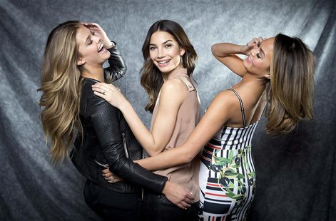 2014 Sports Illustrated cover models Nina Agdal (L), Lily Aldridge and Chrissy Teigen (R) pose for a portrait in New York February 18, 2014.