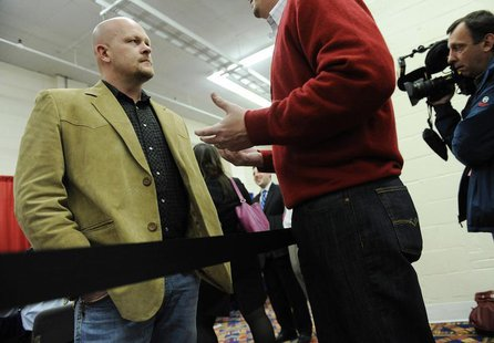 Samuel Joseph Wurzelbacher (L), known as Joe the Plumber, and a Republican congressional candidate in Ohio, speaks to attendees at the Ameri