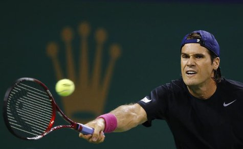 Tommy Haas of Germany hits a shot against Sam Querrey of the U.S. during their men's singles match at the Shanghai Masters tennis tournament