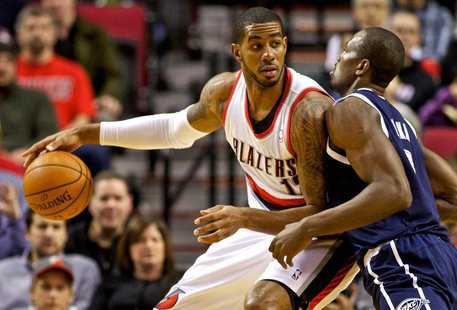 Feb 11, 2014; Portland, OR, USA; Portland Trail Blazers power forward LaMarcus Aldridge (12) posts up against Oklahoma City Thunder power fo