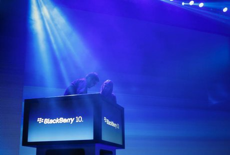 Workers prepare the stage ahead of the launch of Research In Motion Ltd's (RIM) new Blackberry 10 devices in New York January 30, 2013. REUT
