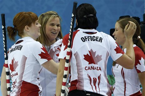 Canada's lead Dawn McEwen, skip Jennifer Jones, Jill Officer and vice Kaitlyn Lawes (L-R) celebrate after winning their women's curling semi