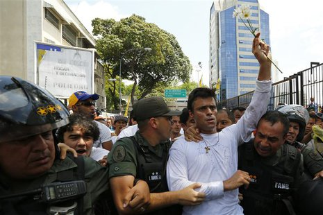 Venezuelan opposition leader Leopoldo Lopez is escorted by national guards before handing himself over in Caracas February 18, 2014. REUTERS