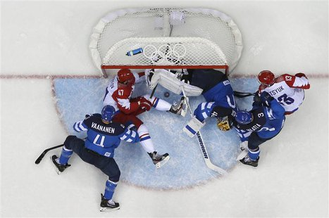Russia's Alexander Radulov (47) tries to push the puck into the goal as Finland's goalie Tuukka Rask (3rd R) defends during the third period