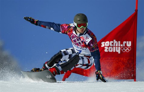 Russia's Vic Wild competes during the men's snowboard parallel giant slalom qualifying heats at the 2014 Sochi Winter Olympic Games in Rosa