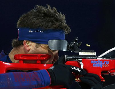 Norway's Ole Einar Bjoerndalen shoots during the mixed biathlon relay at the 2014 Sochi Winter Olympics February 19, 2014. REUTERS/Michael D