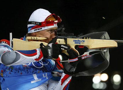 Ondrej Moravec of the Czech Republic shoots during the mixed biathlon relay at the 2014 Sochi Winter Olympics February 19, 2014. REUTERS/Mic