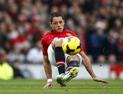 Manchester United's Javier Hernandez controls the ball during their English Premier League soccer match against Newcastle United at Old Traf