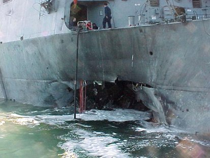 The port side damage to the guided missile destroyer USS Cole is pictured after a bomb attack during a refueling operation in the port of Ad