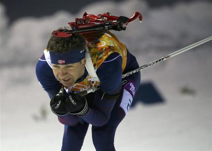 Norway's Ole Einar Bjoerndalen skis during the mixed biathlon relay at the Sochi 2014 Winter Olympics February 19, 2014. REUTERS/Sergei Karp