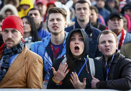 Russian fans react as they watch a broadcast of the ice hockey quarter-final match between Russia and Finland in the Olympic Park during the