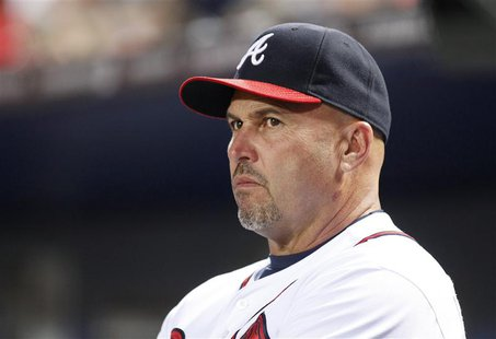 Atlanta Braves manager Fredi Gonzalez watches from the dugout in the fourth inning during play against the Milwaukee Brewers at their MLB Na