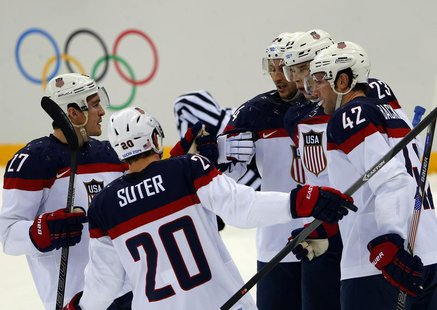 Team USA's David Backes (42) is congratulated by teammates after scoring a goal against Czech Republic during the first period of their men'