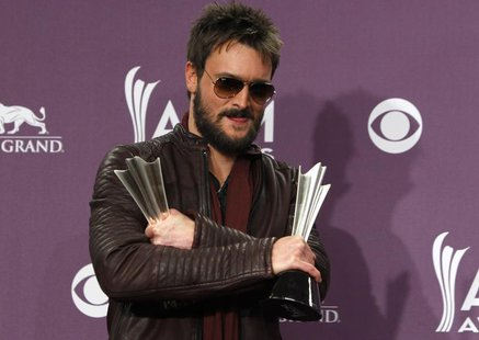 Eric Church holds his awards for album of the year and vocal event of the year at the 48th ACM Awards in Las Vegas April 7, 2013. REUTERS/St