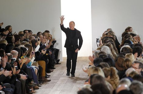 Designer Michael Kors acknowledge guests following his Fall 2014 collection during New York Fashion Week February 12, 2014. REUTERS/Joshua L
