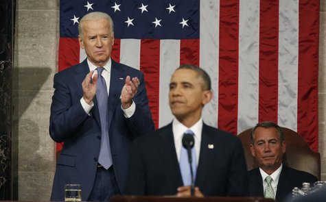 Vice President Joe Biden applauds and Speaker of the House John Boehner looks on as President Barack Obama delivers his State of the Union s
