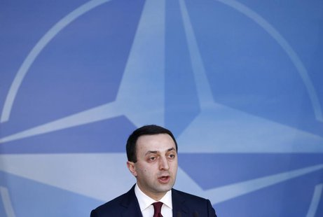 Georgia's Prime Minister Irakly Garibashvili holds a news conference after meeting NATO Secretary-General Anders Fogh Rasmussen (unseen) at