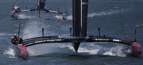 Oracle Team USA sails toward the finish line ahead of Emirates Team New Zealand to win Race 17 of the 34th America's Cup yacht sailing race
