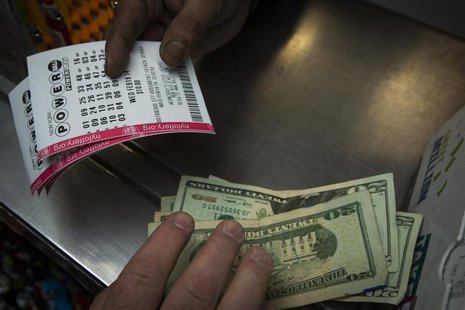 A man purchases New York State Lottery tickets for the $400 million Powerball lottery in New York's financial district February 19, 2014. RE