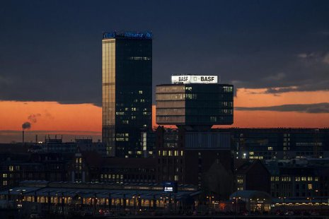 General view of buildings with advertising signs of the German insurer Allianz and the chemical company BASF during sunset in Berlin, Novemb