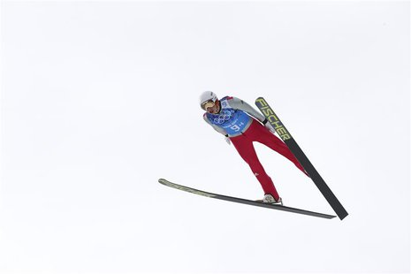 Germany's Eric Frenzel soars through the air during the trial round of the large hill ski jumping portion of the Nordic Combined team Gunder