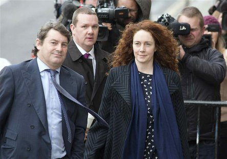 Former News International chief executive Rebekah Brooks and her husband Charlie Brooks (L) arrive at the Old Bailey courthouse in London Fe