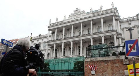 A cameraman films outside Palais Coburg hotel where nuclear talks are taking place in Vienna February 19, 2014. REUTERS/Heinz-Peter Bader