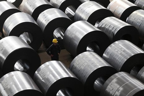 An employee works at a steel factory that exports to Europe and America in Jiaxing, Zhejiang province, February 28, 2013. REUTERS/William Ho