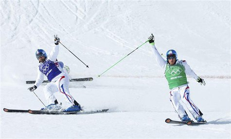 France's Arnaud Bovolenta (L) and France's Jean Frederic Chapuis cross the finish line during the men's freestyle skiing skicross final at t