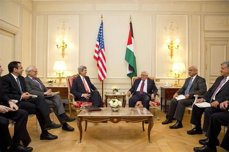 U.S. Secretary of State John Kerry (L) sits with Palestinian President Mahmoud Abbas during their talks in Paris February 19, 2014. REUTERS/