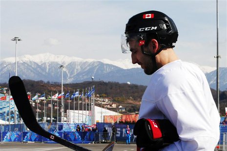 Canada's ice hockey player Patrice Bergeron walks to the Bolshoy arena following a men's team practice at the 2014 Sochi Winter Olympics Feb