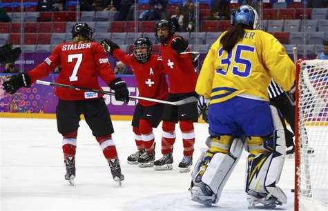 Switzerland's Jessica Lutz (R) celebrates her goal against Sweden's goalie Valentina Wallner (L) with teammates Sara Benz (13) and Lara Stal
