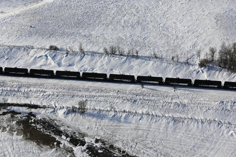 A train makes its way along the Burlington Northern Santa Fe (BNSF) rail line outside of Williston, North Dakota March 12, 2013. REUTERS/Sha