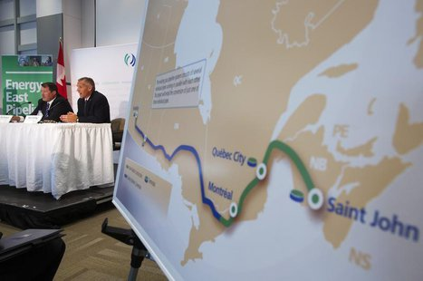 TransCanada President and CEO Russ Girling (2nd L) announces the new Energy East Pipeline during a news conference in Calgary, Alberta, Augu