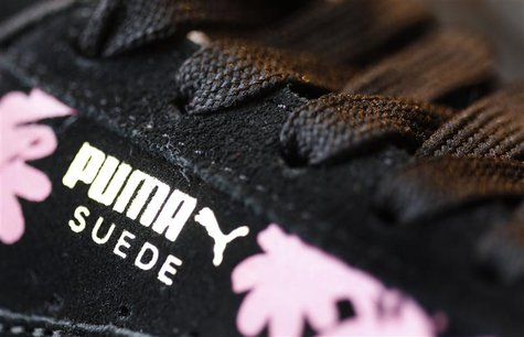 The logo of German sports goods firm Puma is seen on a shoe after the company's annual news conference in Herzogenaurach February 20, 2014.