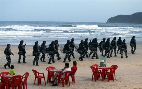 Riot police patrol the Santinho beach next the Costao do Santinho hotel ahead of the 2014 FIFA World Cup in Florianopolis, Santa Catarina st