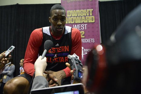 Feb 15, 2014; New Orleans, LA, USA; 2014 Western Conference All-Stars center Dwight Howard (Rockets) (12) talks to the media after the pract