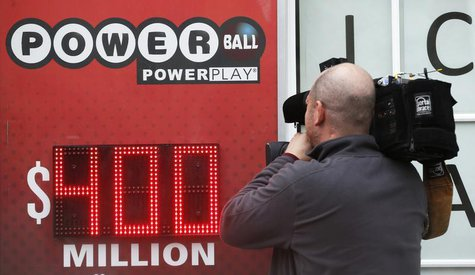A TV cameraman films a sign for Virginia's $400 million Powerball lottery in Arlington, Virginia February 19, 2014. The drawing takes place