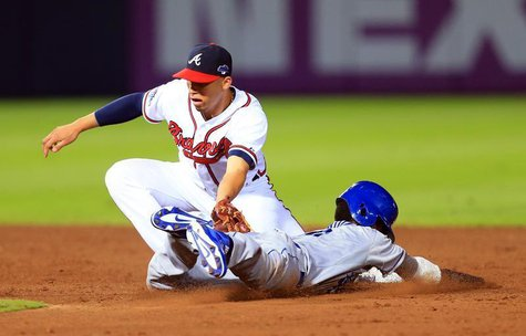 Oct 4, 2013; Atlanta, GA, USA; Atlanta Braves shortstop Andrelton Simmons (19) tags out Los Angeles Dodgers shortstop Dee Gordon (9) on a st