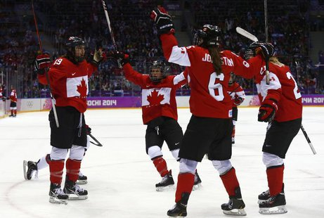Canada's Brianne Jenner (L) celebrates her goal against Team USA with teammates Catherine Ward, Rebecca Johnston (6) and Haley Irwin (R) dur