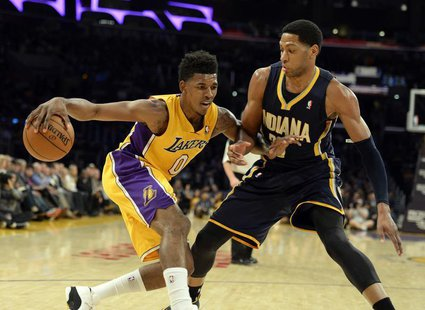 Jan 28, 2014; Los Angeles, CA, USA; Los Angeles Lakers small forward Nick Young (0) controls the ball against Indiana Pacers small forward D