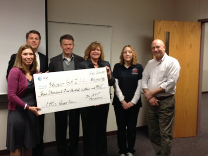 Members associated with LTC's Project GRILL receive the $4,500 check from the AT&T Foundation.