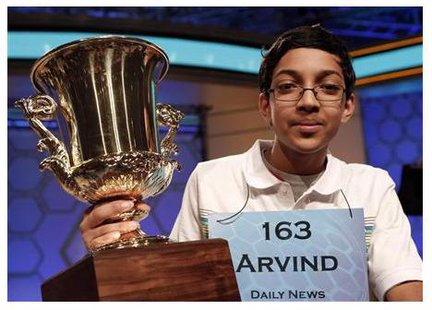 Arvind Mahankali of New York holds his trophy after winning the National Spelling Bee at National Harbor in Maryland May 30, 2013.  CREDIT: REUTERS/KEVIN LAMARQUE