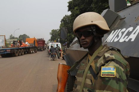 African peace keeping soldiers escort a humanitarian convoy in Bangui, February 15, 2014. REUTERS/Luc Gnago
