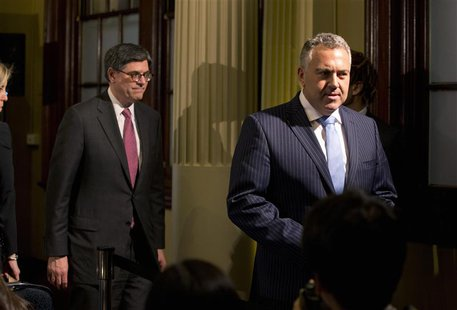 U.S. Treasury Secretary Jack Lew and Australian Treasurer Joe Hockey (R) walk from a joint news conference at the G20 Finance Ministers meet