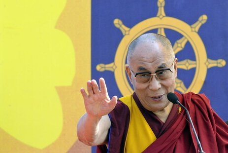 "Exiled Tibetan spiritual leader, the Dalai Lama, addresses a gathering with the theme ""A Human Approach to Peace and the Individual"" at a st"
