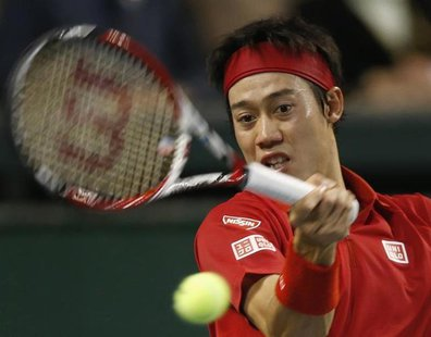 Japan's Kei Nishikori returns a shot against Canada's Frank Dancevic during their Davis Cup world group first round tennis match in Tokyo Fe