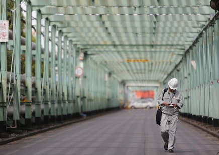 A man walks inside a factory at Keihin industrial zone in Kawasaki, south of Tokyo June 28, 2013. REUTERS/Yuya Shino