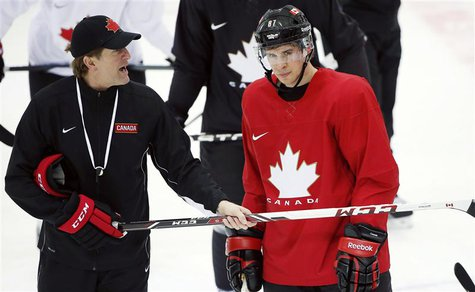 Canada's men's ice hockey team captain Sidney Crosby (R) listens to head coach Mike Babcock give directions during a team practice at the 20