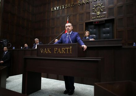 Turkey's Prime Minister Tayyip Erdogan addresses members of parliament from his ruling AK Party (AKP) during a meeting at the Turkish parlia